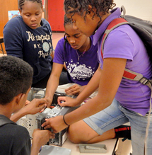 YouthQuest students work on a computer